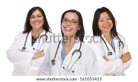 Three Hispanic and Mixed Race Female Doctors or Nurses Isolated on a White Background. - stock photo