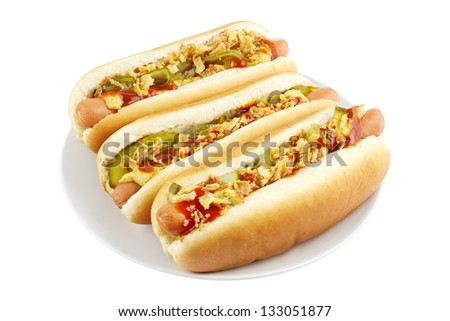 Three hot dogs on a plate isolated on white - stock photo