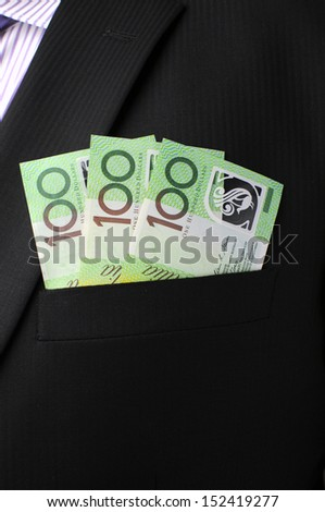 Three hundred dollar notes in business man's black suit top front pocket. V - stock photo