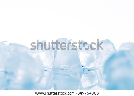 Three ice cubes on white background. studio shot - stock photo