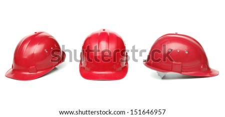 Three identical red hard hat. - stock photo