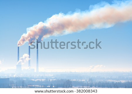 Three industrial chimney with smoke against the sky - stock photo