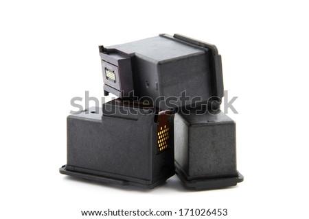 three ink toners piled isolated on white - stock photo