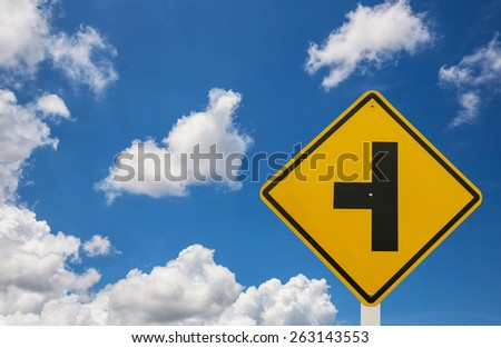 Three intersection traffic sign on blue sky backgroud - stock photo