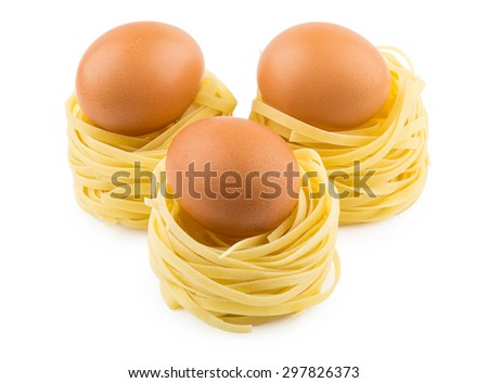 Three italian pasta in form nest and brown egg isolated on white background - stock photo