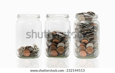 Three jars with different level of coins. - stock photo
