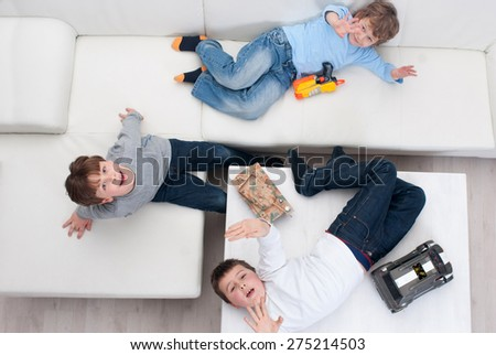 Three kids are on the table together. Top view - stock photo