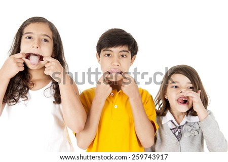 three kids playing, making a grimace - stock photo