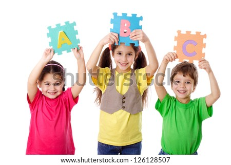 Three kids with colorful letters in raised hands, isolated on white - stock photo