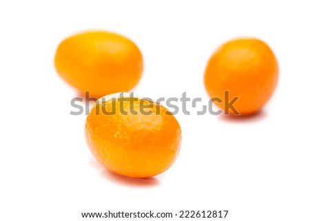 Three kumquats (Fortunella) isolated on white background - stock photo