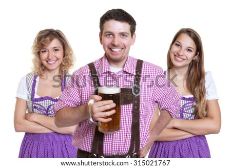Three laughing visitors of the Oktoberfest on an isolated white background for cut out - stock photo