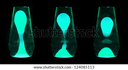 Three lava lamps showing progress of the Aqua wax going up and separating - stock photo