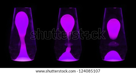 Three lava lamps showing progress of the Purple wax going up and separating - stock photo