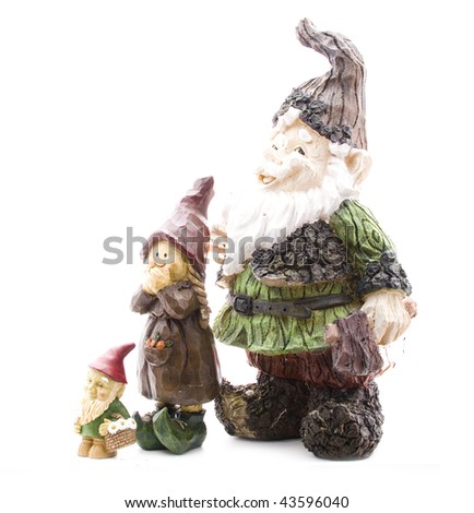 Three Lawn Gnomes on White Standing from Short to Tall - stock photo