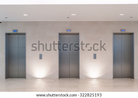 Three lift doors in office building - stock photo