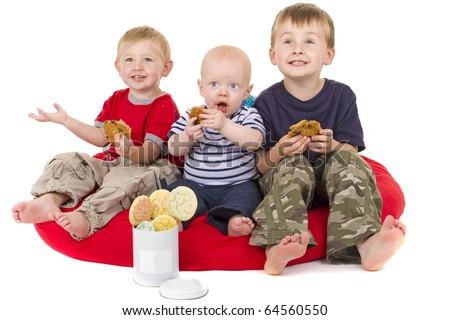 Three Little Boys love to eat cookies - stock photo