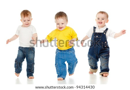 Three little boys playing game and running - stock photo