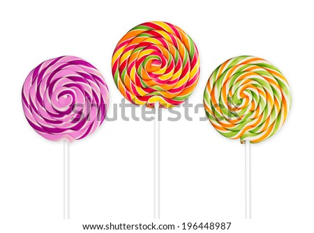 three lolly pops in front of white background - stock photo
