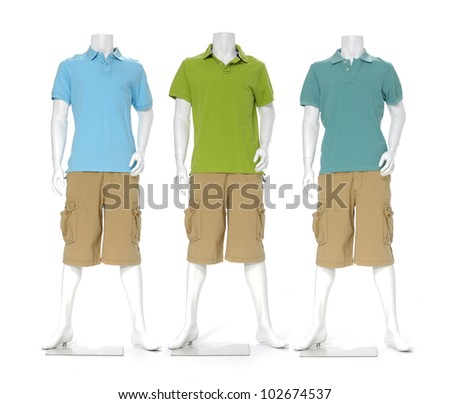 Three male mannequin dressed in t- shirt with short pants - stock photo
