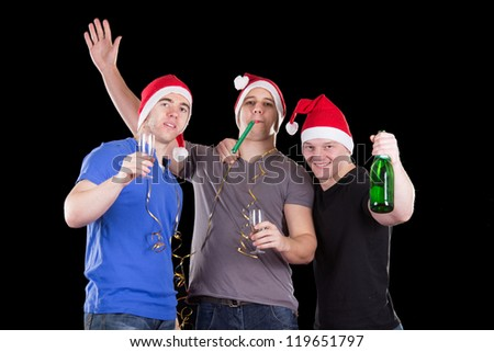 Three man wearing santa hat on a party - stock photo