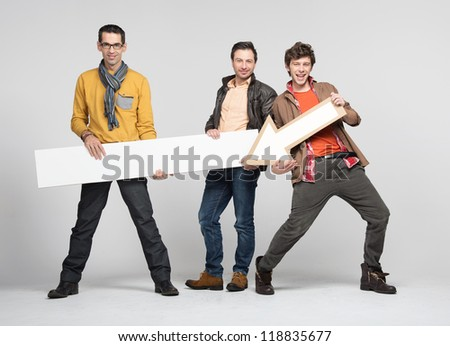 Three man with arrow - stock photo