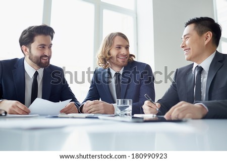 Three managers discussing business plans - stock photo