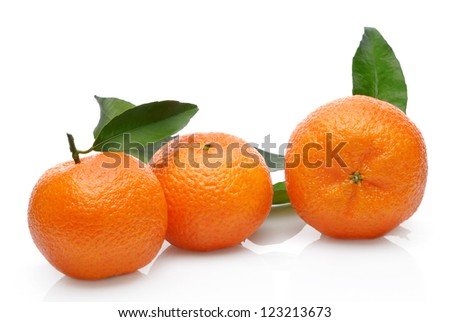 Three mandarin with green leaves isolated on white background - stock photo