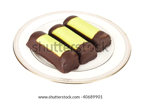 Three Marzipan chocolate bars on the plate isolated on the white. - stock photo