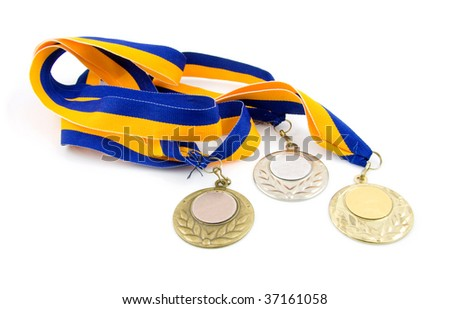 Three medals: gold, silver and bronze, isolated on white background - stock photo