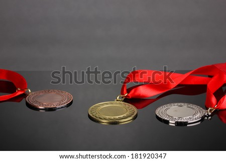 Three medals on grey background - stock photo