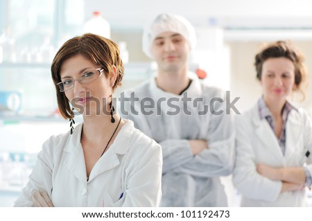 Three medical colleagues standing in laboratory - stock photo