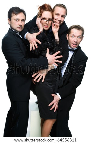 Three men in tuxedos and cheerful girl on white - stock photo