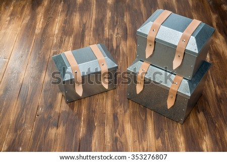 three metal tool box on wooden table, Studio Shot - stock photo