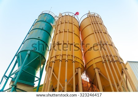 Three metal towers on a chemical factory - stock photo