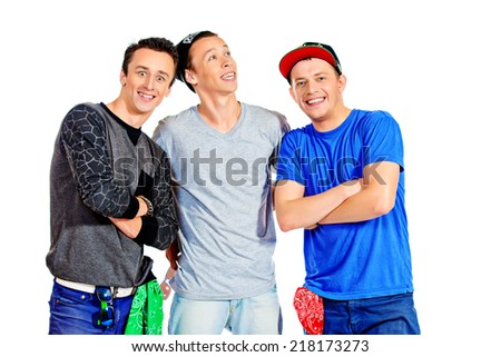Three modern dancers at studio. Isolated over white. - stock photo