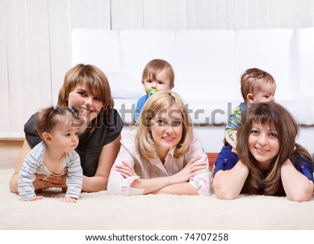 Three mothers with kids, lying - stock photo