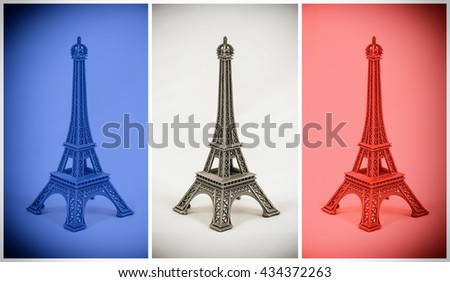 Three multicolored Eiffel Tower models on french flag. Dust and scratches applied for vintage analog effect - stock photo