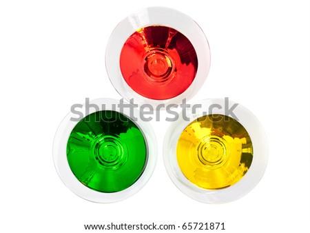 Three multicoloured cocktails in martini glasses top view - stock photo