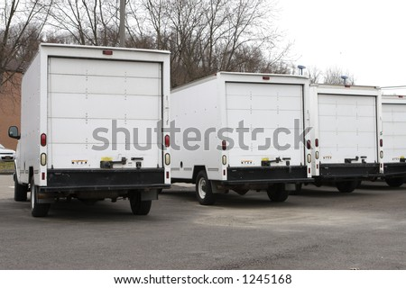 Three New Box Delivery or Moving Trucks - stock photo