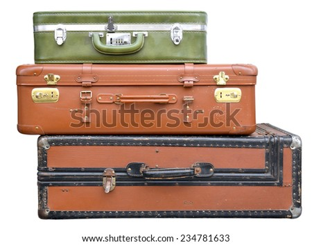 three old and worn suitcases piled up - stock photo