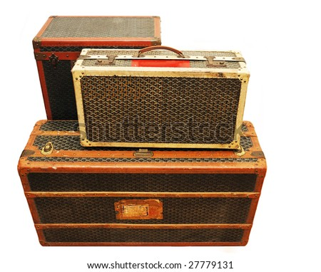 Three old suitcases isolated over white background. - stock photo