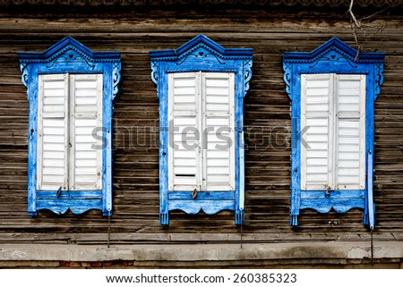 Three old wooden window. Russian traditional style. - stock photo