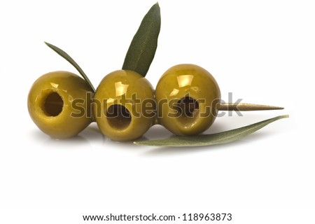 Three olives on a toothpick isolated on a white background - stock photo