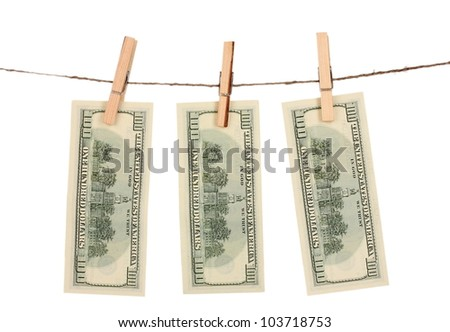 Three one hundred dollar bills is hanging on a rope with wooden clothespin isolated on white - stock photo