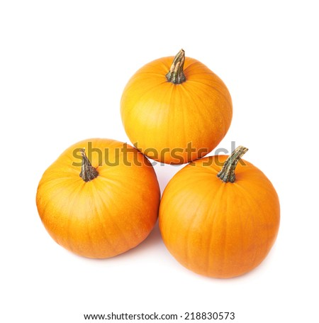 Three orange pumpkin composition isolated over the white background - stock photo