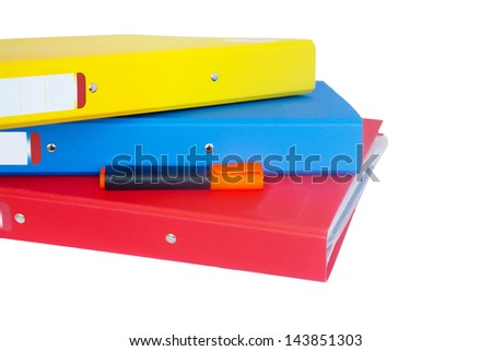 Three organizers piled with a marker (isolated) - stock photo
