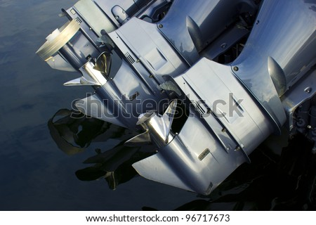 Three outboard boat motors - stock photo