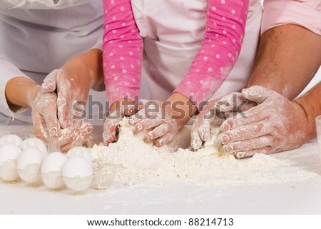 Three pair of Hands kneading  dough - stock photo