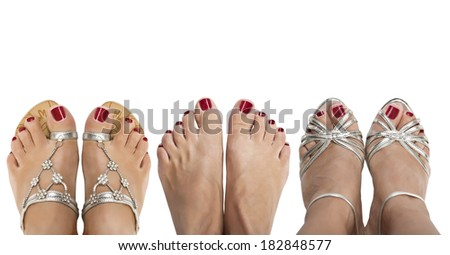 Three pairs of female legs on a white background. View from the top. - stock photo