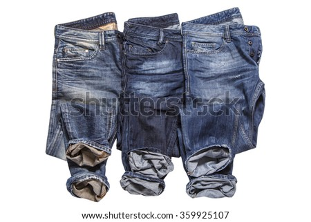 Three pairs of jeans - stock photo